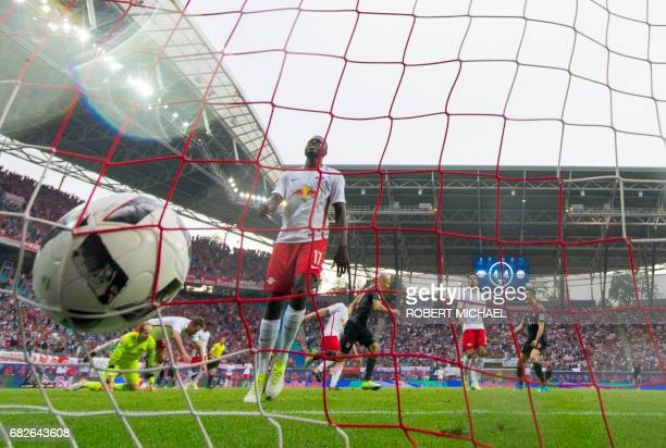 Leipzig's French defender Dayot Upamecano reacts after Bayern Munich's Dutch midfielder Arjen Robben scored during the German first division...