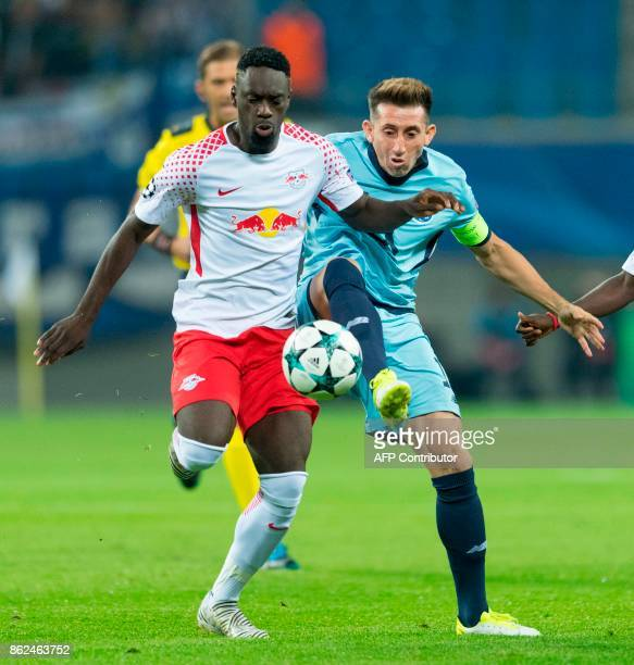 Leipzig´s French forward JeanKevin Augustin and Porto´s Spanish midfielder Oliver Torres vie for the ball during the UEFA Champions League group G...