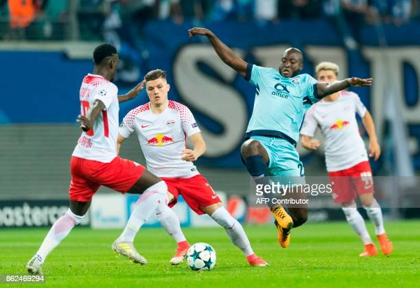 Leipzig´s French forward JeanKevin Augustin Austrian forward Marcel Sabitzer and Porto´s Portuguese midfielder Danilo Pereira vie for the ball during...