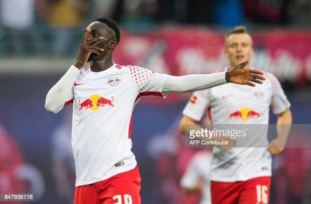 Leipzig's French forward JeanKevin Augustin celebrates scoring the 21 goal during the German first division Bundesliga football match RB Leipzig v...