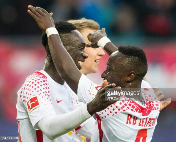 Leipzig's French forward JeanKevin Augustin celebrates scoring the 21 goal with Guinean midfielder Naby Deco Keita during the German first division...