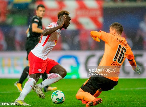 Leipzig's French forward JeanKevin Augustin vies with Stuttgart's goalkeeper RonRobert Zieler during the German first division Bundesliga football...