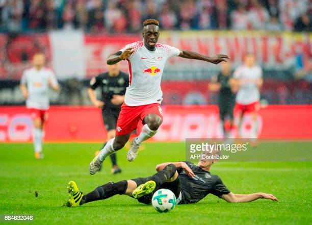 Leipzig's French forward JeanKevin Augustin vies with Stuttgart's defender Timo Baumgartl during the German first division Bundesliga football match...