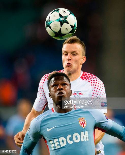 Leipzig's German defender Lukas Klostermann and Monaco´s Senegalese forward Keita Balde vie for the ball during the UEFA Champions League group G...