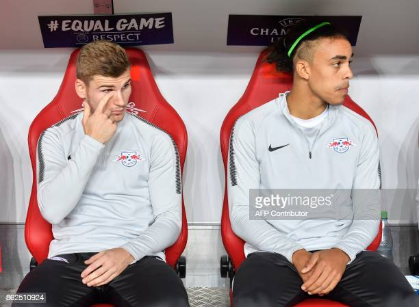 Leipzig's German forward Timo Werner and Leipzig's Danish forward Yussuf Poulsen sit ion the bench prior to the UEFA Champions League group G...