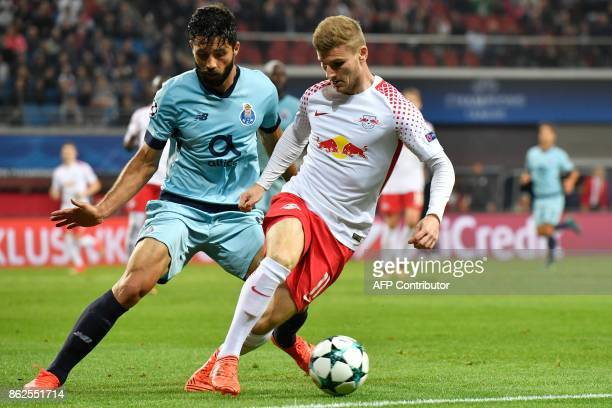 Leipzig's German forward Timo Werner and Porto's Brazilian defender Felipe vie for the ball during the UEFA Champions League group G football match...