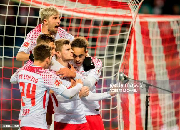 Leipzig's German forward Timo Werner celebrates after scoring a penalty with his teammate from L midfielder Dominik Kaiser defender Willi Orban...