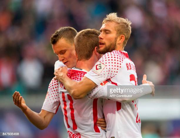 Leipzig´s German forward Timo Werner celebrates scoring the opening goal with German defender Lukas Klostermann and Austrian midfielder Konrad Laimer...