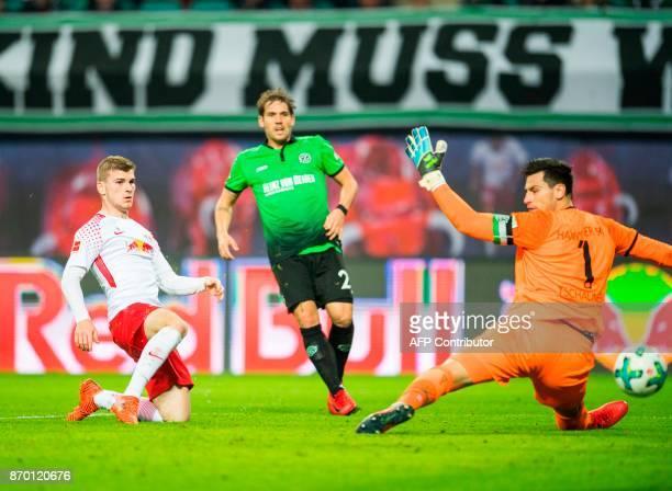 Leipzig's German forward Timo Werner scores against Hanover's German goalkeeper Philipp Tschauner during the German first division Bundesliga...