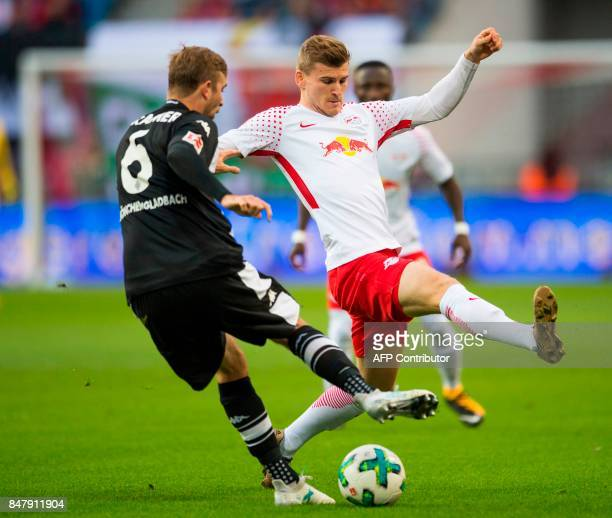 Leipzig´s Germanforward Timo Werner and Moenchengladbach's German midfielder Christoph Kramer vie for the ball during the German first division...
