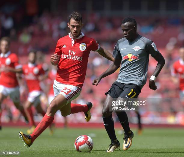 Leipzig's GuineaBissauborn Portuguese midfielder Bruma vies with Benfica's Portuguese defender Pedro Pereira during the preseason friendly football...