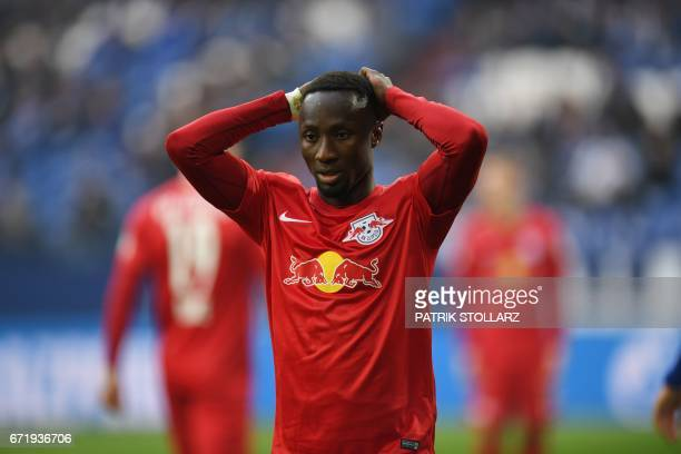 Leipzig´s Guinean midfielder Nabi Keita reacts during the German first division Bundesliga football match of FC Schalke vs RB Leipzig in...