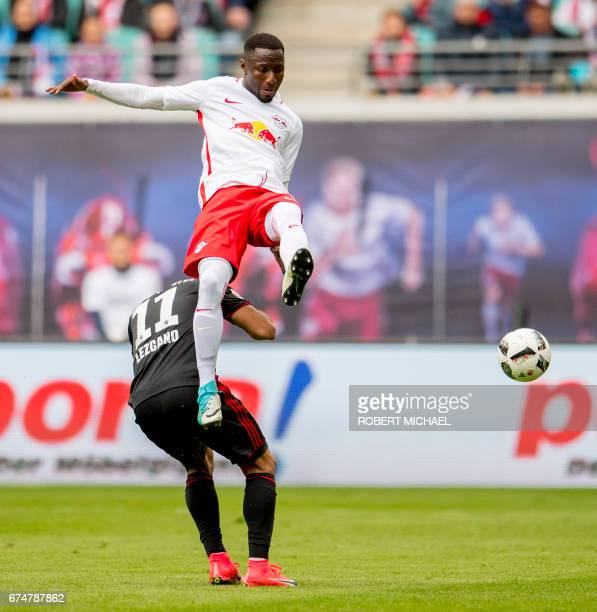 Leipzig´s Guinean midfielder Naby Deco Keita and Ingolstadt´s Paraguayan forward Dario Lezcano vie for the ball during the German first division...