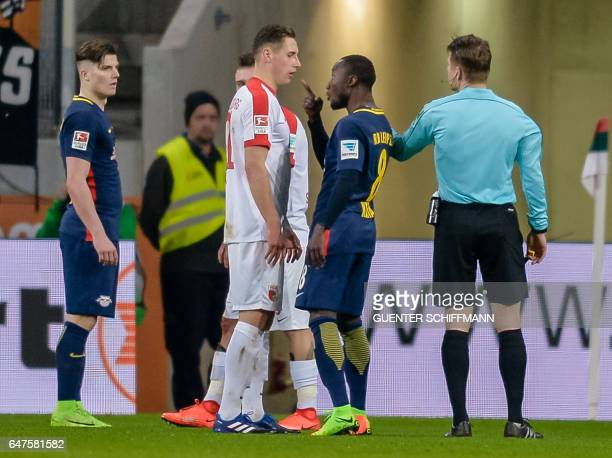 Leipzig's Guinean midfielder Naby Keita argues with Augsburg's German midfielder Dominik Kohr during the German first division Bundesliga football...