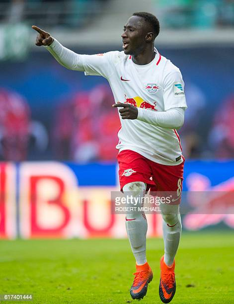 Leipzig's Guinean midfielder Naby Keita celebrates after scoring the second goal during the German first division Bundesliga football match between...