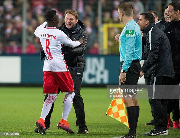Leipzig's Guinean midfielder Naby Keita celebrates after scoring the opening goal with head coach Ralph Hasenhuettl during the German first division...