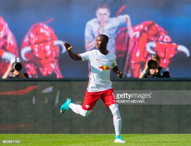 Leipzig's Guinean midfielder Naby Keita celebrates after scoring the 10 during the German First division Bundesliga football match between RB Leipzig...