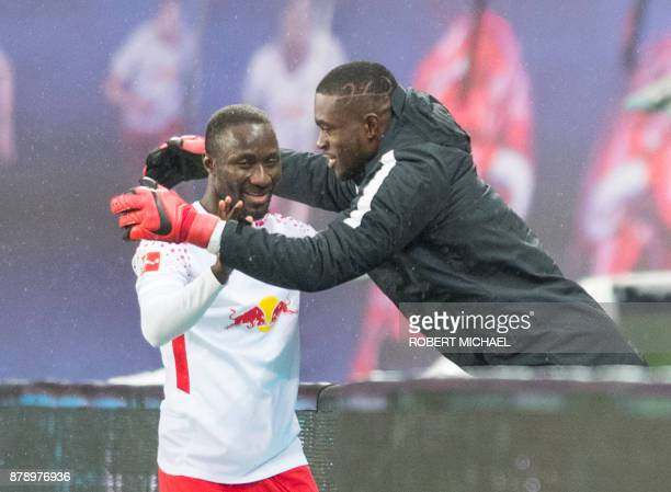 Leipzig's Guinean midfielder Naby Keita celebrates scoring with Leipzig's Swiss goalkeeper Yvon Mvogo during the German first division Bundesliga...