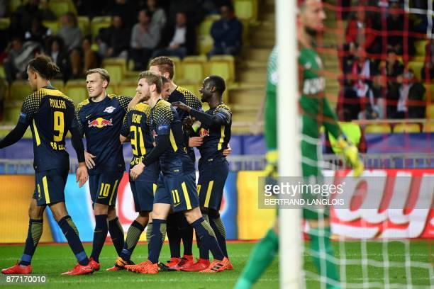 Leipzig's Guinean midfielder Naby Keita celebrates with teammates after scoring a goal during the UEFA Champions League group G football match...