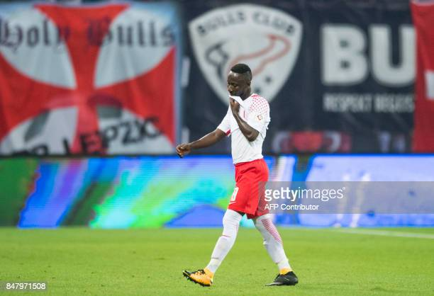 Leipzig's Guinean midfielder Naby Keita leaves the field after receiving a red card during the German first division Bundesliga football match RB...