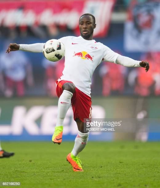 CORRECTION Leipzig's Guinean midfielder Naby Keita plays the ball during the German First division Bundesliga football match of RB Leipzig vs VfL...