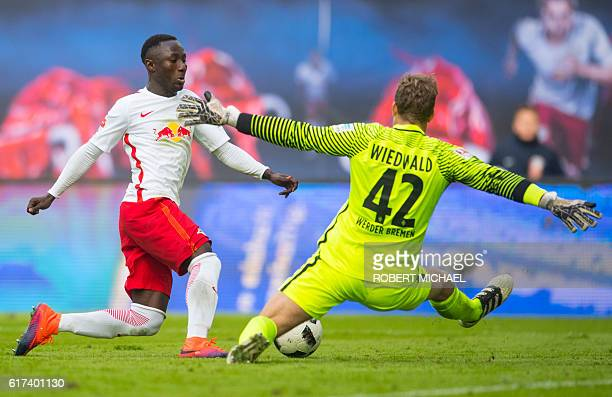 Leipzig's Guinean midfielder Naby Keita scores the first goal past Bremen's goalkeeper Felix Wiedwald during the German first division Bundesliga...