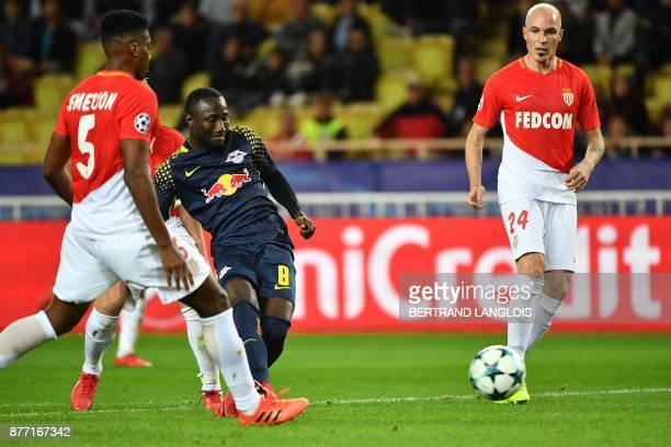 Leipzig's Guinean midfielder Naby Keita shoots and scores during the UEFA Champions League group G football match between Monaco and Leipzig at the...