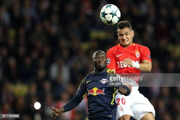 Leipzig's Guinean midfielder Naby Keita vies for the ball with Monaco's Portuguese midfielder Rony Lopes during the UEFA Champions League group G...