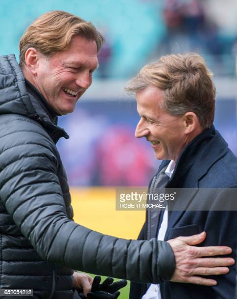 Leipzig's head coach Ralph Hasenhuettl and Wolfsburg's Dutch head coach Andries Jonker chat prior to the German First division Bundesliga football...