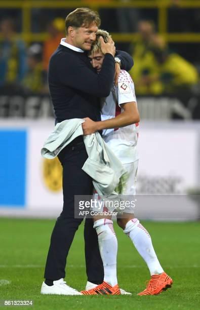 Leipzig's headcoach Ralph Hasenhuettl hugs Leipzig's Slovanian midfielder Kevin Kampl after Leipzig won the German First division Bundesliga football...