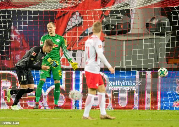Leipzig's Hungarian goalkeeper Peter Gulacsi reacts as Mainz' Danish forward Emil Berggreen scores during the German first division Bundesliga...