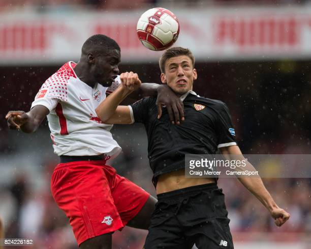 Leipzig's JeanKevin Augustin battles for possession with Sevilla's Clement Lenglet during the Emirates Cup match between RB Leipzig and Sevilla FC at...