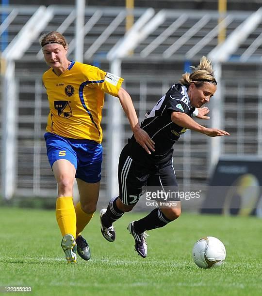 Leipzig's Kathrin Patzke battles for the ball with Sandra Smisek of Frankfurt during the Women's Bundesliga match between 1 FC Lok Leipzig and 1 FFC...