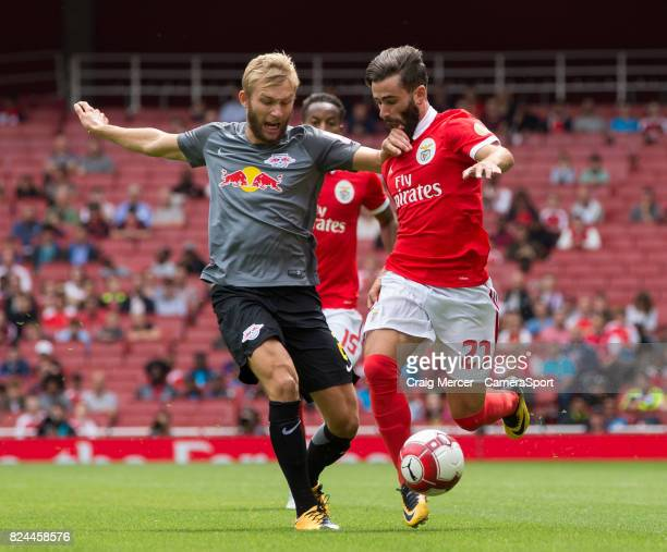 Leipzig's Konrad Laimer vies for possession with Benficas Rafa Silva during the Emirates Cup match between RB Leipzig and SL Benfica at Emirates...