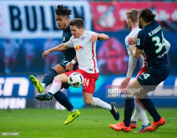 Leipzig's midfielder Dominik Kaiser and Wolfsburg's midfielder Daniel Didavi vie for the ball during the German First division Bundesliga football...
