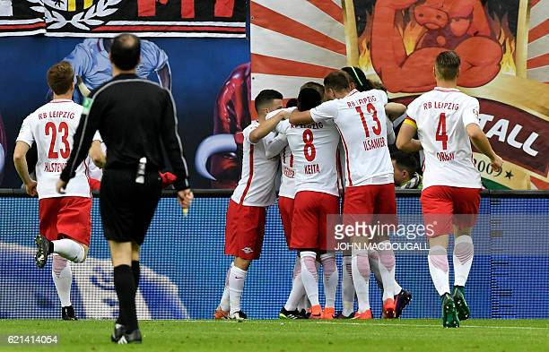 Leipzig's players celebrate after Leipzig's forward Timo Werner's goal during the German first division Bundesliga football match between RB Leipzig...