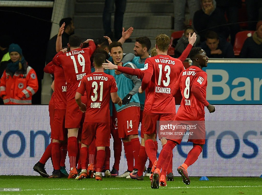 Leipzig´s players celebrate during the German first division Bundesliga football match of Bayer Leverkusen vs RB Leipzig in Leverkusen, western Germany, on November 18, 2016. / AFP / PATRIK