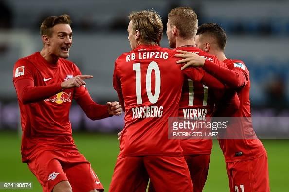 Leipzig´s players celebrate scoring during the German first division Bundesliga football match of Bayer Leverkusen vs RB Leipzig in Leverkusen...