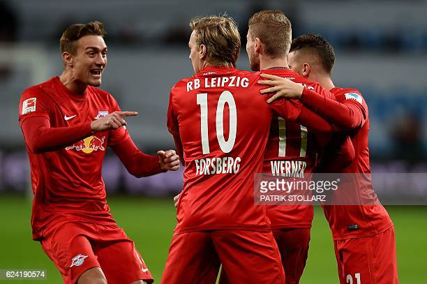 Leipzig´s players celebrate scoring during the German first division Bundesliga football match of Bayer Leverkusen vs RB Leipzig in Leverkusen...