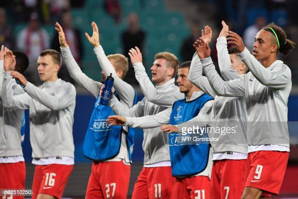 Leipzig's players including Leipzig's Danish forward Yussuf Poulsen celebrate after the UEFA Champions League group G football match RB Leipzig v FC...