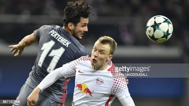 Leipzig's Portuguese midfielder Bruma and Besiktas' forward Mustafa Pektemek vie for the ball during the UEFA Champions League group G football match...