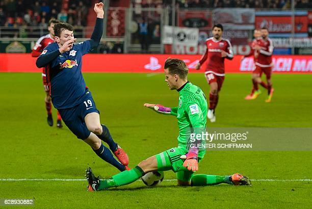 Leipzig's Scottish midfielder Oliver Burke and Ingolstadt's Norwegian keeper Oerjan Nyland vie for the ball during the German first division...