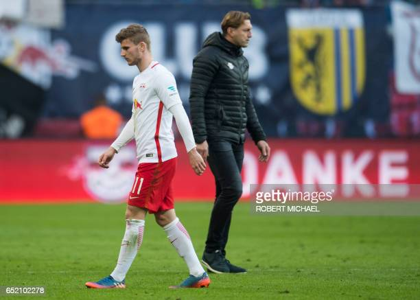 Leipzig's striker Timo Werner and Austrian head coach Ralph Hasenhhuettl leave the pitch after the German First division Bundesliga football match of...