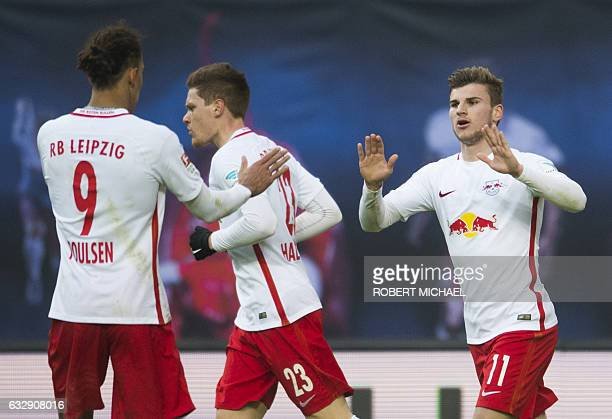 Leipzig's striker Timo Werner celebrates after scoring with his teamate defender Marcel Halstenberg and Danish forward Yussuf Poulsen during the...