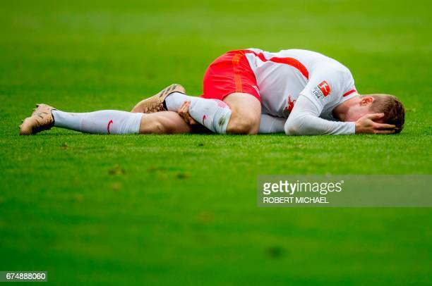 Leipzig´s striker Timo Werner lays on the pitch after a foul during the German first division Bundesliga football match between RB Leipzig and FC...