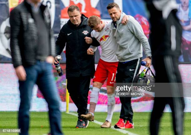Leipzig's striker Timo Werner leaves the pitch following injury during the German first division Bundesliga football match between RB Leipzig and FC...