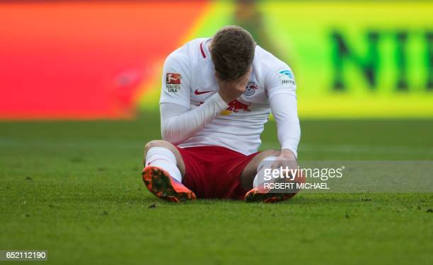 Leipzig's striker Timo Werner sits on the pitch during the German First division Bundesliga football match of RB Leipzig vs VfL Wolfsburg in Leipzig...