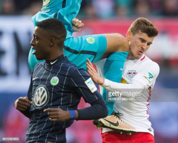 Leipzig's striker Timo Werner Wolfsburg's goalkeeper Koen Casteels and Wolfsburg's Dutch midfielder Riechedly Bazoer vie for the ball during the...