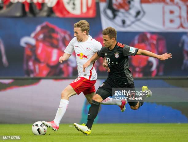 Leipzig´s Swedish forward Emil Forsberg and Munich´s midfielder Joshua Kimmich vie for the ball during the German first division Bundesliga football...
