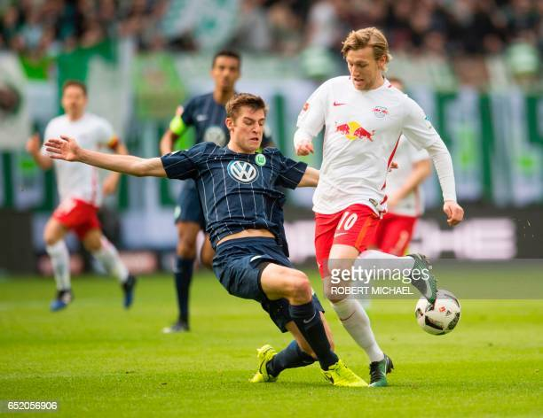 Leipzig's Swedish forward Emil Forsberg and Wolfsburg's defender Robin Knoche vie for the ball during the German First division Bundesliga football...